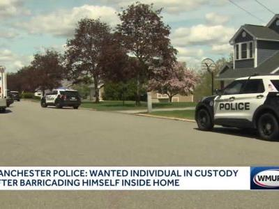 Wanted man arrested after barricading himself in Manchester home, police say