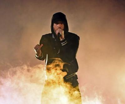 Eminem just surprised his fans by releasing a new 13-track album called 'Kamikaze'