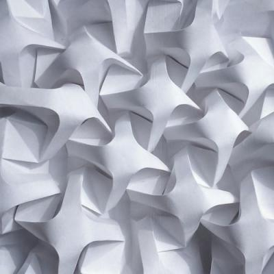 Tessellating Patterns Formed From Intricately Folded Paper by
