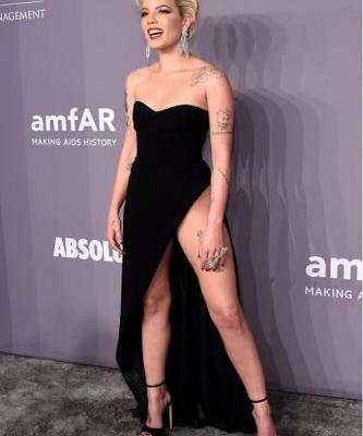 Fearless in her GEORGES HOBEIKA Gown, Halsey attends the 2018