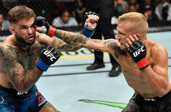 TJ Dillashaw retains the bantamweight title with a TKO win over Cody Garbrandt | HIGHLIGHTS | UFC 227