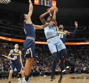 Jokic scores 27 as Nuggets hold off Grizzlies 105-99
