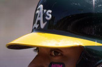 A's place Khris Davis on injured list with hip contusion