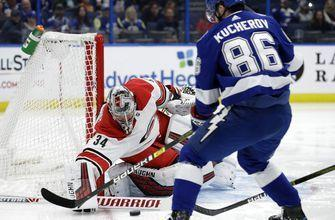 Point has 2 late goals, Lightning beat Hurricanes 3-1