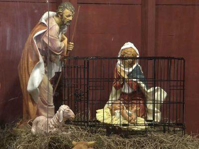 Church locks Nativity scene's baby Jesus in metal cage as political message