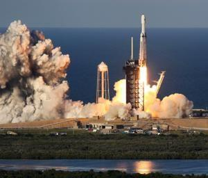 SpaceX launches Falcon Heavy, sticks 3-booster landing