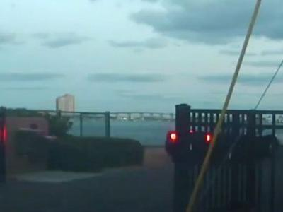 Watch A Man Deliberately Drive A Ferrari Off A Dock At Speed