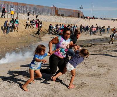 US agents fire tear gas at migrants in start of border clashes with Mexico