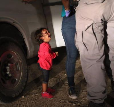 A photographer shares the heartbreaking story behind that viral photo of a 2-year-old crying at the border