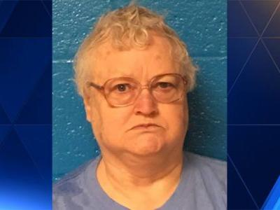 Woman concealed mother's body, wanted to see it decompose, police say