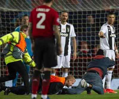 Pitch invader nearly gets to Cristiano Ronaldo during Champions League