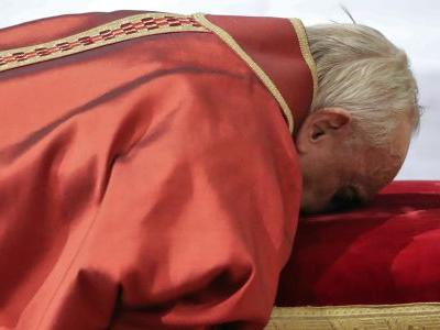 Pope presides over Good Friday amid security, controversy