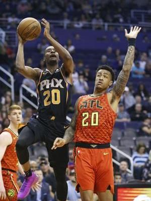 Collins, Young lift Suns past Hawks, 118-112