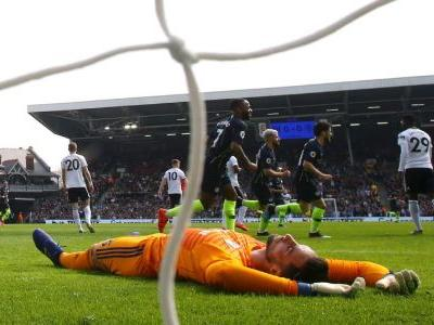 Man City ease back to the top with victory at Fulham