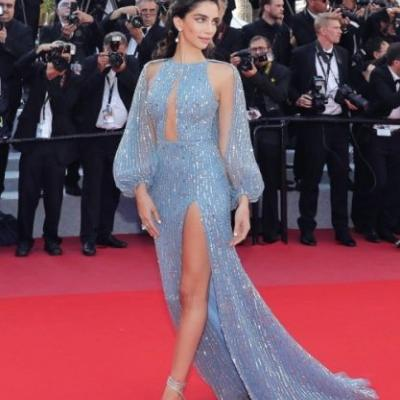 Jessica Kahawaty shines in a blue, tulle dress embroidered with