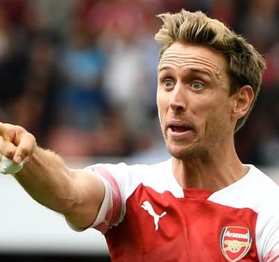 Arsenal defenders Monreal and Sokratis face fitness tests before Sporting visit
