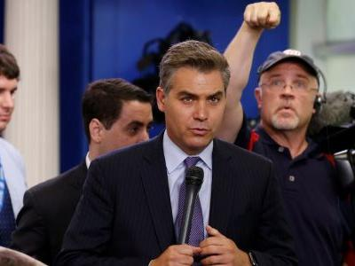 White House suspends CNN correspondent Jim Acosta's press pass after heated exchange with Trump
