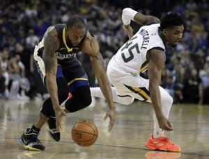 Curry heats up late, Warriors roll past Jazz 115-108