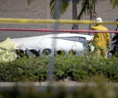 5 killed when small plane crashes in parking lot