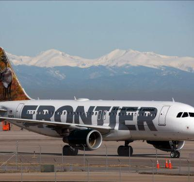 A Frontier Airlines passenger was caught urinating on the seat in front of him after reportedly harassing 2 female passengers