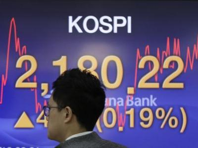 Asian shares advance as investors watch US-China trade talks