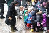 Meghan Markle and Prince Harry Brave the Snow to Meet Adorable Toddlers in Princess Dresses