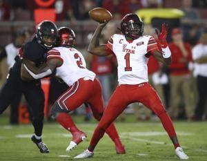 Utah beats No. 14 Stanford 40-21 as injured Love sits out