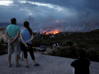 Devastating wildfires in Greece kill 50 while dozens stranded on the beach watched their homes burn