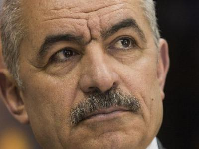 AP interview: Palestinian PM accuses US of 'financial war'
