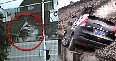 Watch The Moment A Hapless Honda Driver Crashed Into Someone's Roof