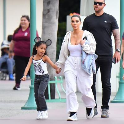 These Pictures of Kim Kardashian and North West Holding Hands at Disneyland Will Melt Your Icy Heart