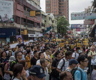 Protesters clash with Hong Kong police in rally against Chinese traders