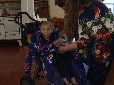 Parents create bodycoat to help wheelchair-bound daughter stay warm